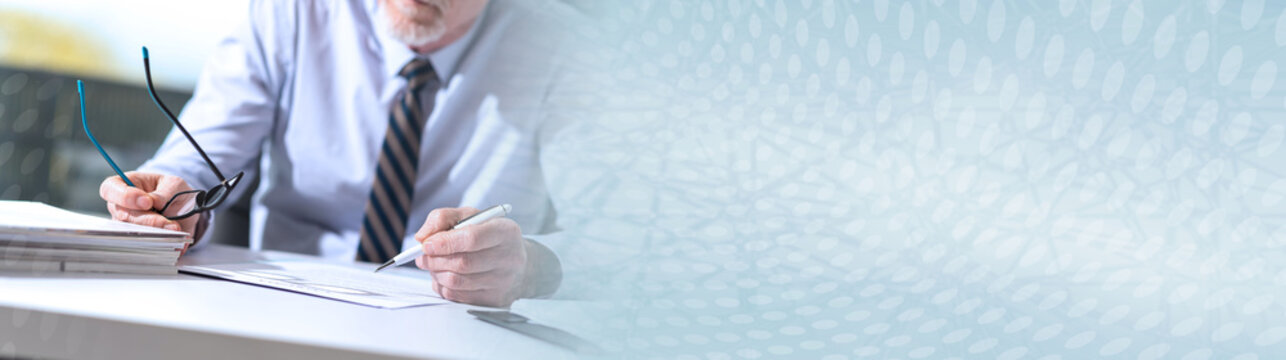 Businessman checking a document; panoramic banner