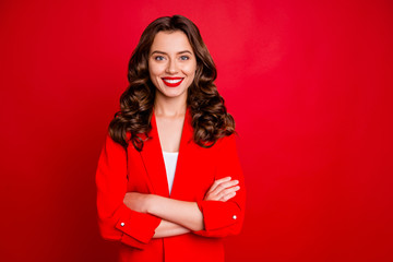 Amazing business lady with crossed arms dressed formal wear red jacket isolated burgundy background
