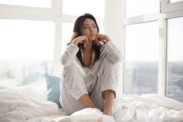 Depressed Woman on Bed at Home