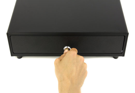 closed black cash drawer or cashbox and hand with key in lock, top view white background
