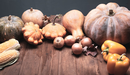 autumn pumpkins and other fruits and vegetables on wooden thanksgiving table Fototapete