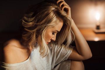 Night portrait of beautiful blonde sensual Caucasian woman posing.
