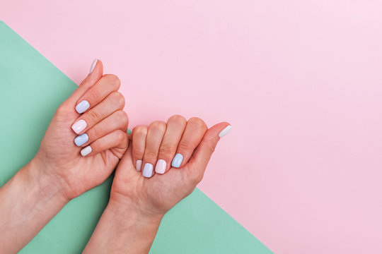 Woman's hands with beautiful salon manicure in light colors