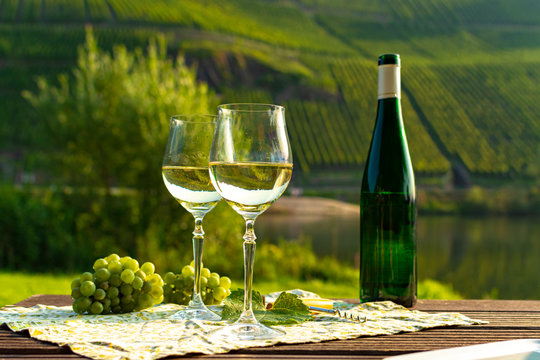 Famous German quality white wine riesling, produced in Mosel wine regio from white grapes growing on slopes of hills in Mosel river valley in Germany