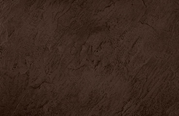 Close up of abstract dark brown stone texture with high resolution.