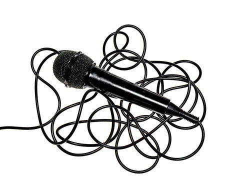 Black microphone with black wire on a white background