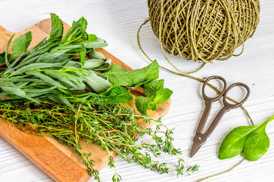 harvesting herbs for winter on wooden background