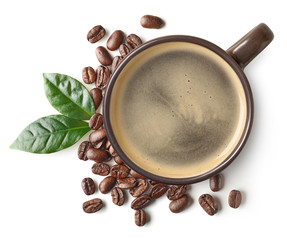 Cup of black coffee and beans with leaves