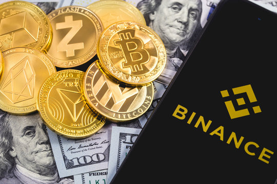 Apple iPhone and Binance logo, and dollars, cryptocurrency. Binance is a cryptocurrency exchange. Ekaterinburg, Russia - September 19, 2018