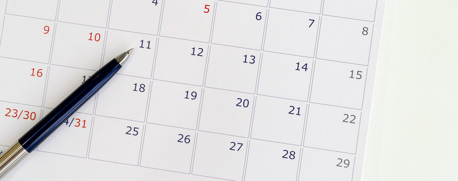 close up top view of calendar at desk for business event date concept