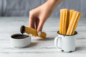 Churros with chocolate, a traditional Spanish sweet food pastry dessert, on white background