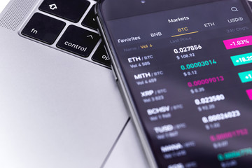 Notebook, smartphone with cryptocurrency stock market