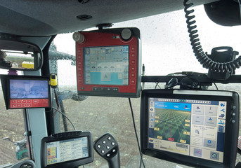 Tractor with GPS system for Planting potatoes. Agriculture. Farming Machines Fototapete