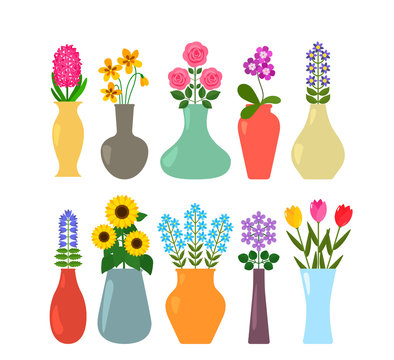 Set of colored vases with blooming flowers for interior design.