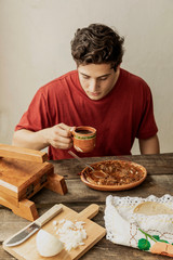 Fototapete - Mexican food. Plate of birria. Man esting.
