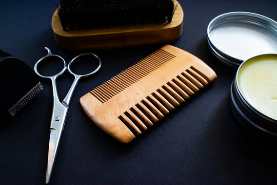 Materials for a perfect beard. Scissor, shaver, comb, wax and brush, all made with natural materials