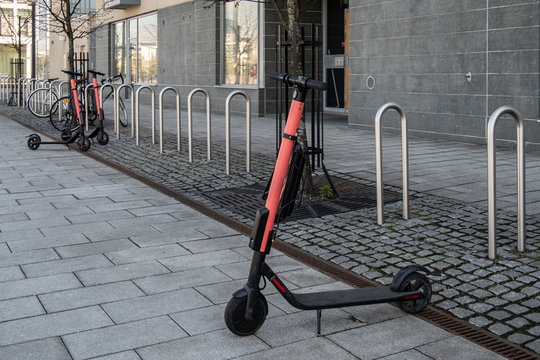 E-Scooters parked on a sidewalk in Helsinki, Finland