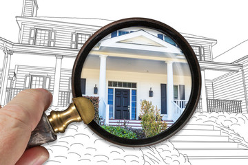 Hand Holding Magnifying Glass Revealing Finished House Build Over Drawing