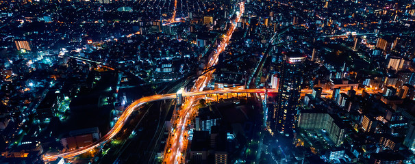 Spoed Foto op Canvas Nacht snelweg Aerial view of the Osaka cityscape at night