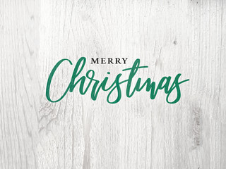 Wall Mural - Merry Christmas Green Graphic Calligraphy Text Design With White Wood Background