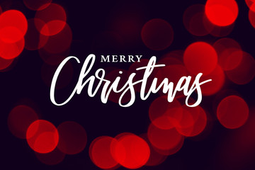 Wall Mural - Merry Christmas Calligraphy with Red Holiday Bokeh Lights Background