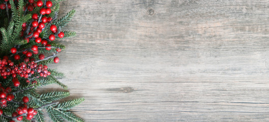 Christmas Holiday Evergreen Pine Branches and Red Berries Over Wood Background, Copy Space Fototapete