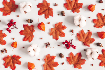 Autumn composition. Pattern made of flowers, maple leaves on gray background. Autumn, fall, thanksgiving day concept. Flat lay, top view