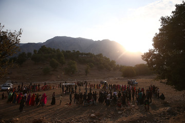 Invitees are seen during the traditional wedding of Sahar and Zal Sahbazi, an Iranian nomad bride and groom, at Bazoft town in Chaharmahal and Bakhtiari Province