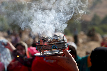 An Iranian woman caaries incense during the traditional wedding of Sahar and Zal Sahbazi, Iranian nomad bride and groom, at Bazoft town in Chaharmahal and Bakhtiari Province
