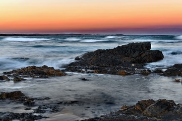 Wall Mural - Australian Coastline Diamond Beach dramatic sunset with smoke haze