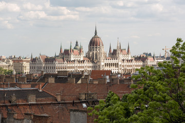 Fotobehang Boedapest Hungarian Parliament in Budapest, view over the city roofs