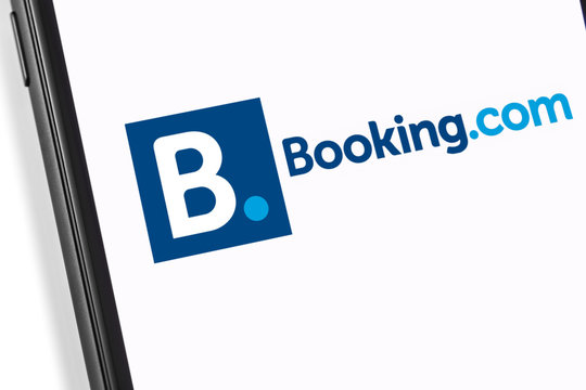 smartphone with Booking logo on the screen. Booking.com is service for booking rooms, enabling people to lease or rent short-term lodging. Moscow, Russia - March 17, 2019