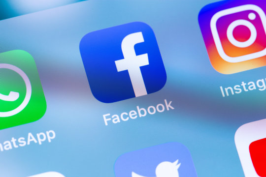 Social media. Facebook icon app on the screen smartphone. Facebook is largest and most popular social networking site in the world. Moscow, Russia - March 15, 2019