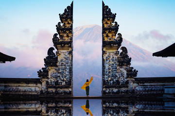 Aluminium Prints Bali Female tourist at temple gates of heaven