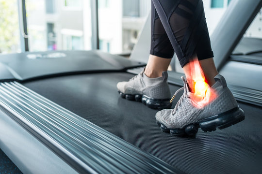 Woman on a treadmill with a painful injury on the ankle