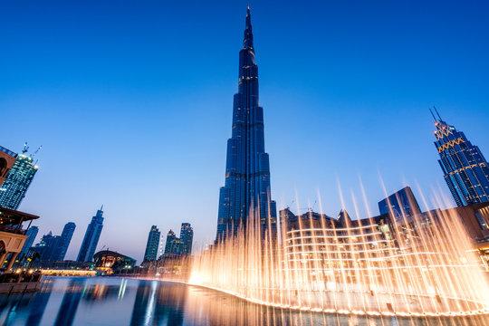 Fountains in Dubai mall overlooking Dubai cityscape and buildings