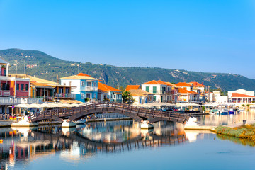 Lefkas (Lefkada) town, amazing view at the small marina for the fishing boats with the nice wooden bridge and promenade, Ionian island, Greece