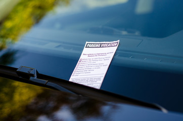 Close-up of parking ticket on car's windshield Wall mural