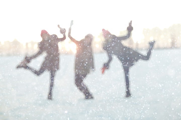 blurred background silhouettes of people fun winter nature