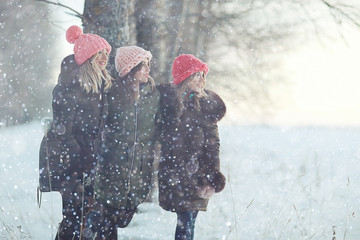 Group of a stylish young girlfriends walking outdoors in winter