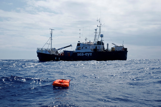 A life jacket floats on the water during a training exercise by the German NGO Sea-Eye migrant rescue ship 'Alan Kurdi' while on its way to the search and rescue zone off the North African coast, in the western Mediterranean Sea