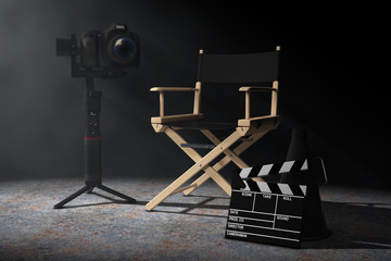 Cinema Industry Concept. DSLR or Video Camera Gimbal Stabilization Tripod System near Director Chair, Movie Clapper and Megaphone in the volumetric light. 3d Rendering