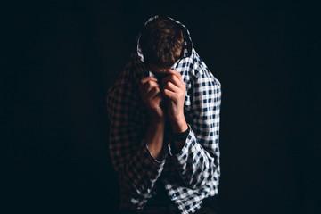 Boy Hiding His Face in Shirt