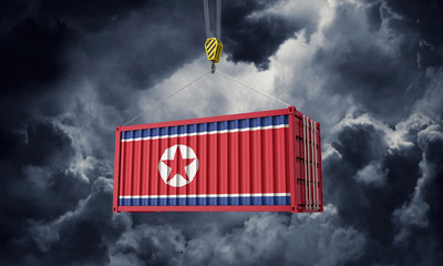 North Korea trade cargo container hanging against dark clouds. 3D Render Wall mural