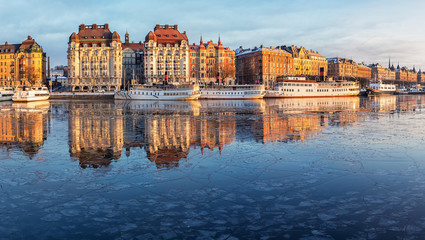 Stockholm waterfront with old architecture reflecting in the frozen bay in winter.