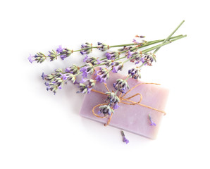 Wall Mural - Hand made soap bar with lavender flowers on white background, top view