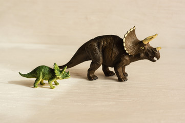 horned triceratops with cub. plastic dinosaur figures of extinct ancient creatures and  favorite toys of kids Wall mural