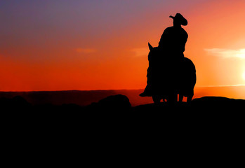 silhouette of cowboy on horse