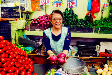 Woman showing onions in market
