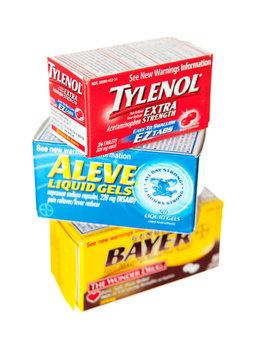 Saint Louis, MO . USA - 02.02.2011: Tylenol, Bayer Aspirin and Aleve Medicines On White Background